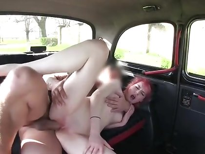 Young redhead banged hard on the backseat