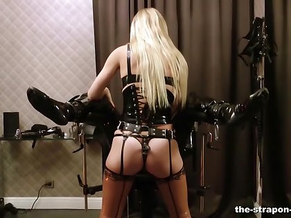 Dominant tow-headed Lady Estelle gives the brush slave a rough dick torture