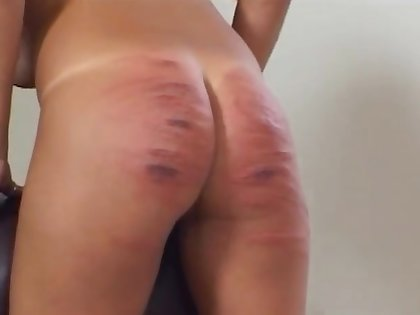 Slut enjoys having her ass spanked hard off out of one's mind a medial blonde
