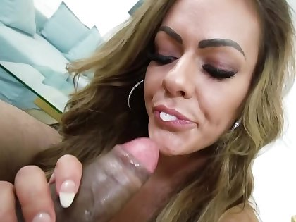 Long-haired MILF pleases black cameraman with great blowjob